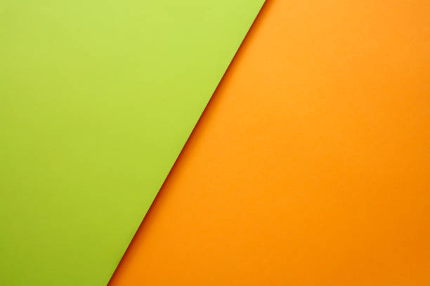 Abstract geometricpaper background in green and orange colors stock photo