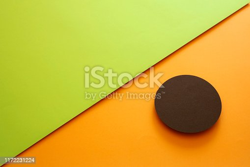 857920492istockphoto Abstract geometricpaper background in green and orange colors 1172231224