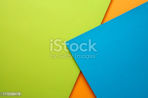 857920492istockphoto Abstract geometricpaper background in green,blue and orange colors 1172230179