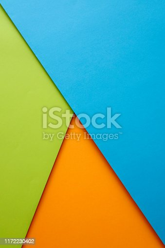 857920492istockphoto Abstract geometricpaper background in green,blue and orange colors 1172230402