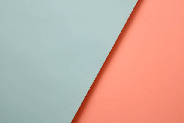 Abstract geometricpaper background in soft pastel blue and living colar colors stock photo