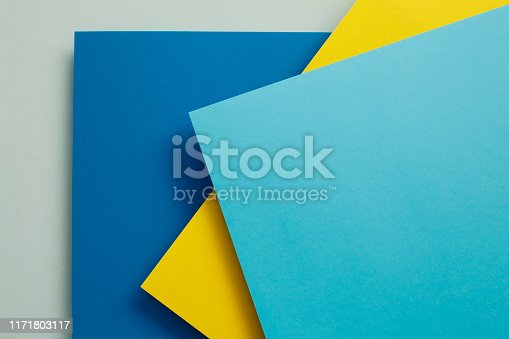 857920492istockphoto Abstract geometricpaper background in soft pastel blue colors 1171803117