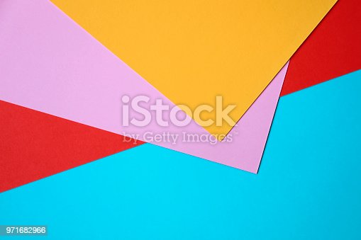 857920492istockphoto Abstract geometricpaper background in soft pastel blue orange and red colors 971682966