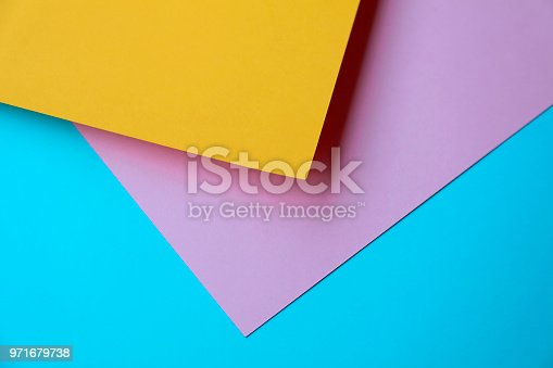 857920492istockphoto Abstract geometricpaper background in soft pastel blue yellow and pink colors 971679738
