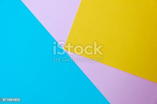 857920492istockphoto Abstract geometricpaper background in soft pastel blue yellow and pink colors 971681820