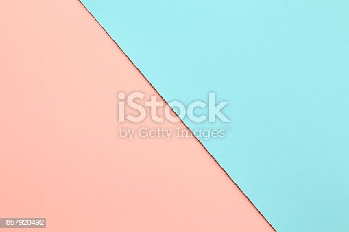 Abstract geometric water color paper background in soft pastel pink and blue trend colors with diagonal line.
