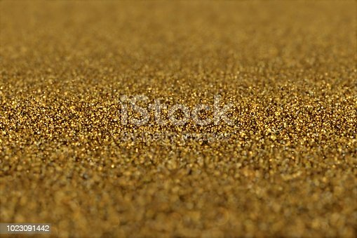 istock Abstract Glamour Background of Glitter Golden Particles. 1023091442