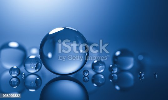 istock abstract glass spheres or plastic ball - blue background - 3d illustration rendering 958205332