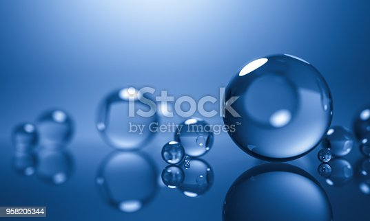 585059140 istock photo abstract glass spheres or plastic ball - blue background - 3d illustration rendering 958205344