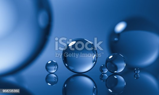 istock abstract glass spheres or plastic ball - blue background - 3d illustration rendering 958205350