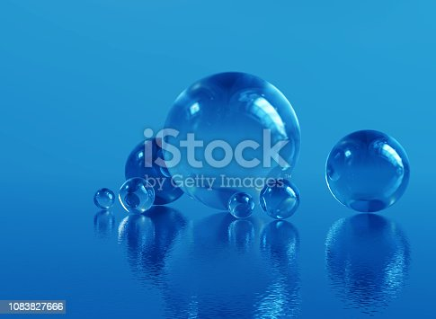 585059140 istock photo Abstract glass spheres or plastic ball - blue background 1083827666