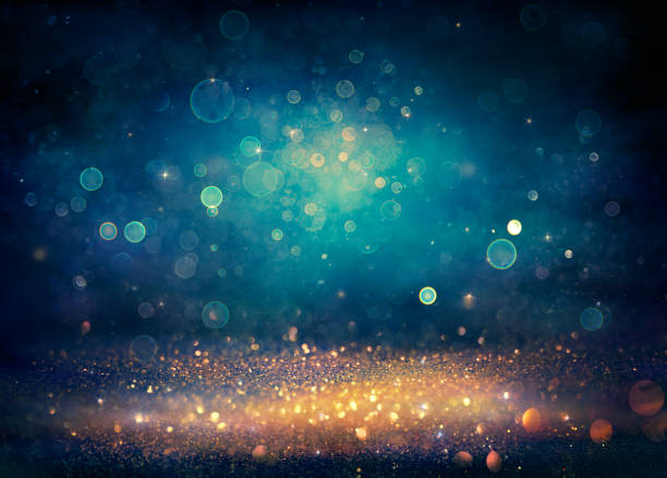 Abstract Glitter Background - Golden And Blue Defocused Lights - Vintage Filter stock photo