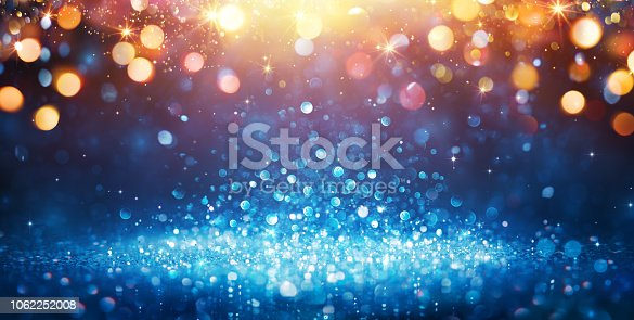 istock Abstract Glittering - Blue Glitter With Golden Christmas Lights And Shiny sparkling Background 1062252008