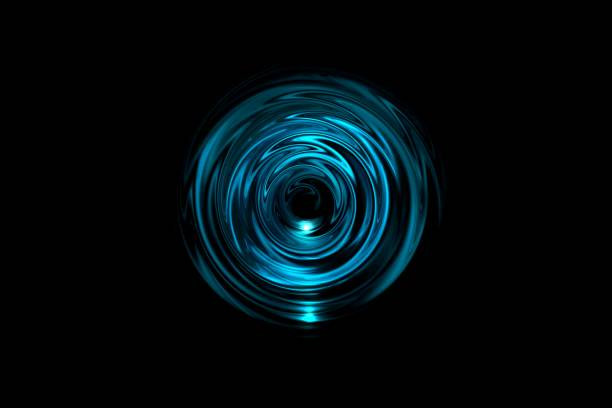 abstract glowing blue vortex with light ring on black background - onda radio foto e immagini stock