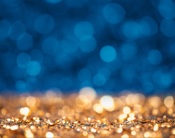 Abstract gold and blue glittering surface stock photo