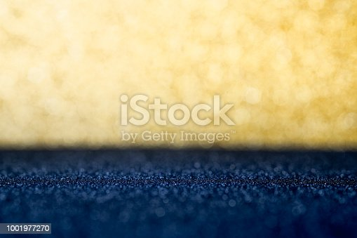 Abstract gold and dark blue sparkling bokeh wall and floor background studio.luxury holiday backdrop mock up for display of product.holiday festive greeting card