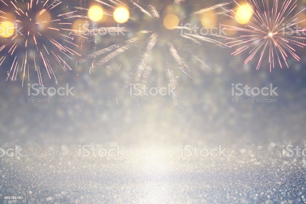 abstract gold and silver glitter background with fireworks. christmas eve, 4th of july holiday concept. stock photo