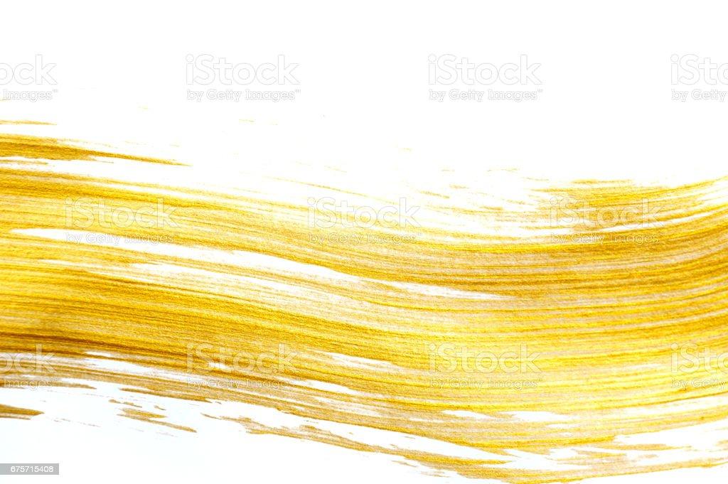 用丙烯酸漆刷的抽象金背景 免版稅 stock photo
