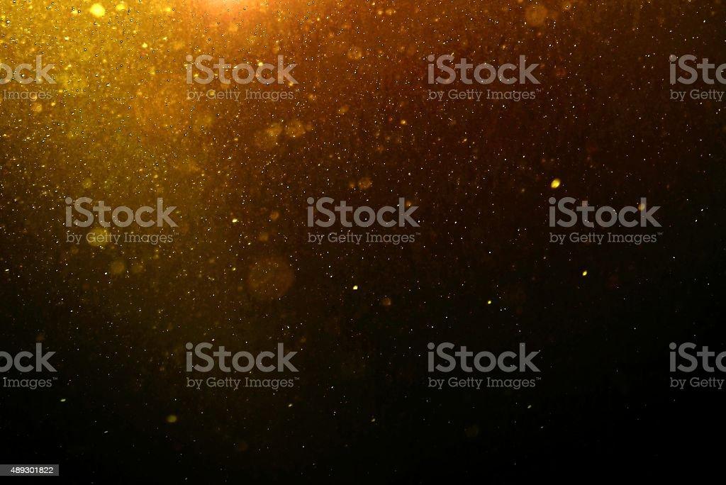 Abstrait fond or avec flottant de poussière - Photo de 2015 libre de droits