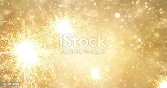 istock Abstract gold bright fireworks and sparkler at new year background 881350658