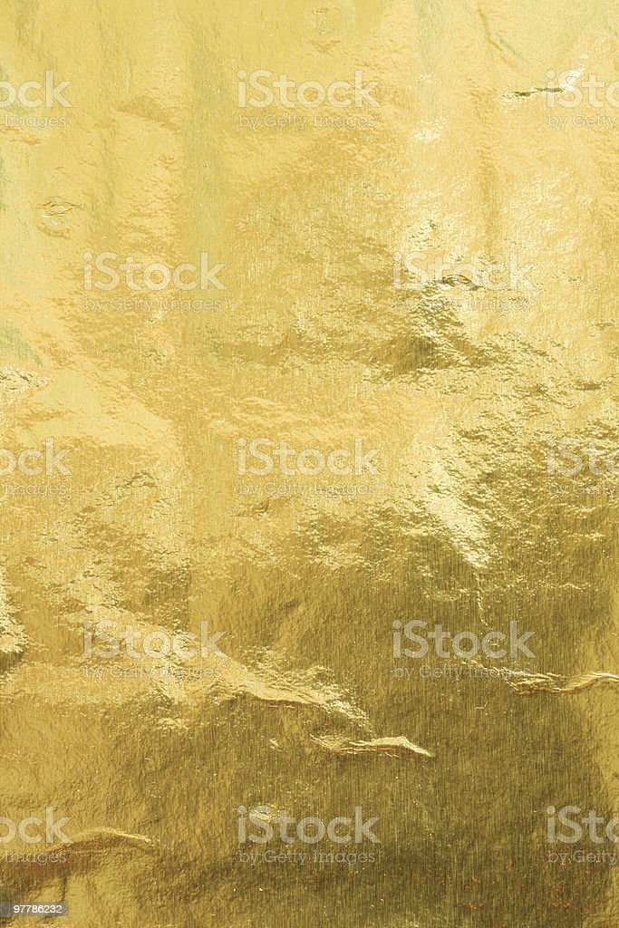 Abstract gold foil texture background royalty-free stock photo