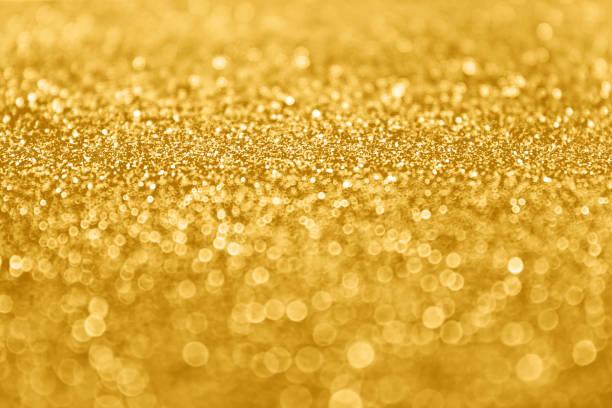 abstrakte gold glitter pailletten funkeln hintergrund - einladungskarten 50. geburtstag stock-fotos und bilder