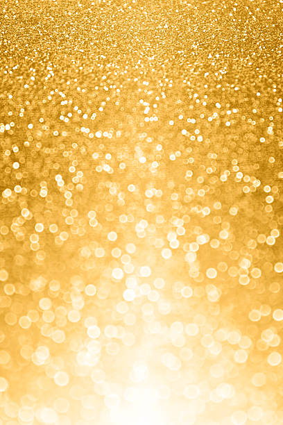 Abstract gold glitter sparkle luxury background stock photo