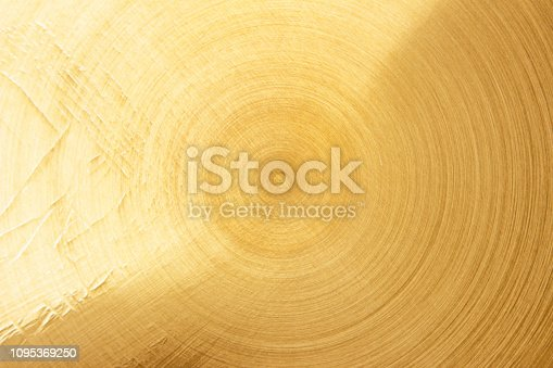 1053870408 istock photo Abstract Gold polished metal brushed background or Shiny yellow leaf gold steel texture. Brushed metal plate with reflected light golden. 1095369250