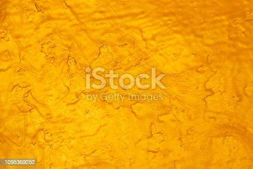 1053870408 istock photo Abstract Gold polished metal brushed background or Shiny yellow leaf gold steel texture. Brushed metal plate with reflected light golden. 1095369252