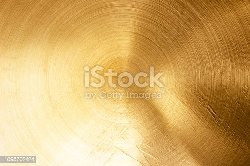 1053870408 istock photo Abstract Gold polished metal brushed background or Shiny yellow leaf gold steel texture. Brushed metal plate with reflected light golden. 1095702424