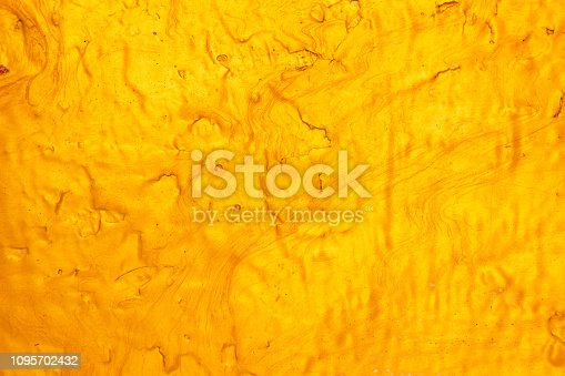 1053870408 istock photo Abstract Gold polished metal brushed background or Shiny yellow leaf gold steel texture. Brushed metal plate with reflected light golden. 1095702432