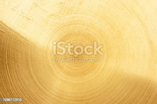 1053870408 istock photo Abstract Gold polished metal brushed background or Shiny yellow leaf gold steel texture. Brushed metal plate with reflected light golden. 1096712510