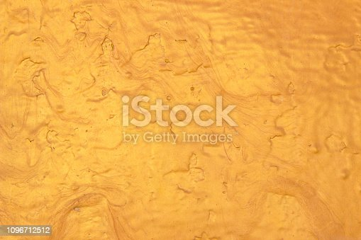 1053870408 istock photo Abstract Gold polished metal brushed background or Shiny yellow leaf gold steel texture. Brushed metal plate with reflected light golden. 1096712512