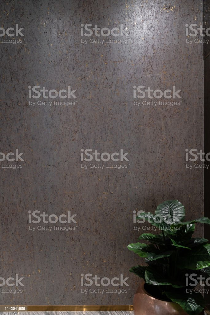 Abstract gold splatter pattern wallcovering texture with artificial...