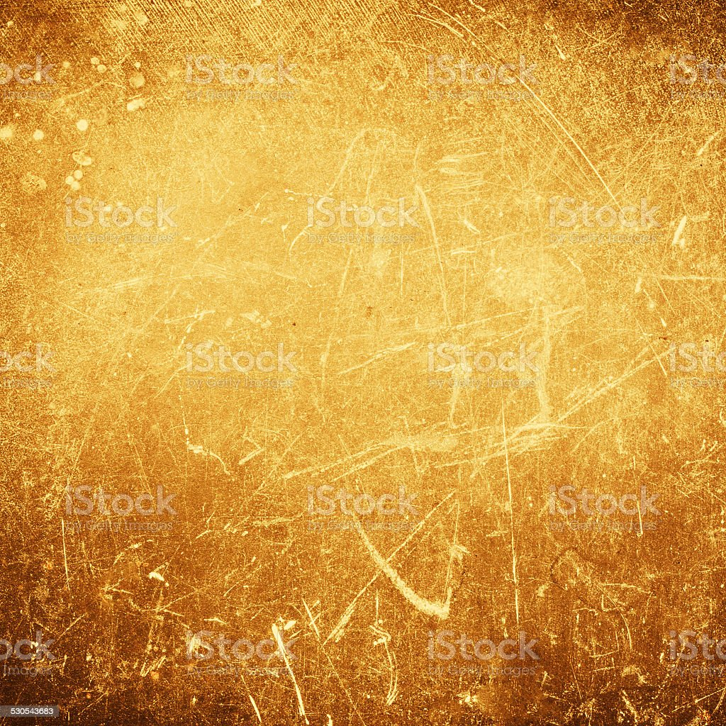 Abstract gold textured  background with spotlight and scratches. stock photo