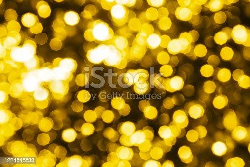 823240022 istock photo Abstract golden blurred bokeh background, defocused round yellow & white shiny dots texture, beautiful gold glowing pattern, bright holiday lights decorative backdrop, festive sparkling wallpaper 1224545533
