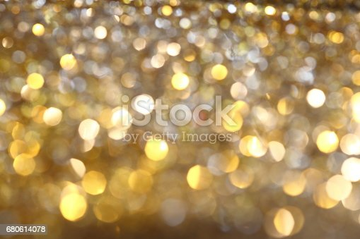 istock Abstract Golden Bokeh background with shining defocus sparkles 680614078