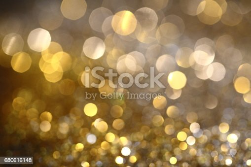 991205326 istock photo Abstract Golden Bokeh background with shining defocus sparkles 680616148