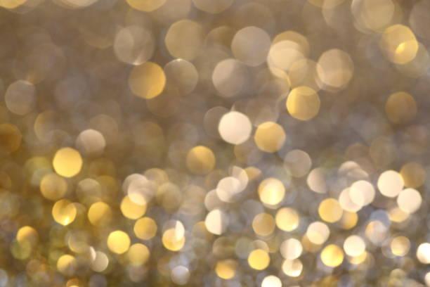 abstrakte goldene bokeh-hintergrund mit leuchtenden defocus funkelt - promi schmuck stock-fotos und bilder