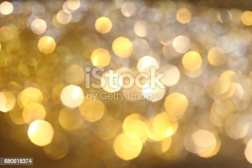 991205326 istock photo Abstract Golden Bokeh background with shining defocus sparkles 680618374