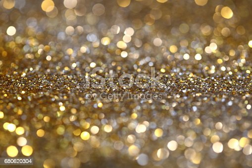 991205326 istock photo Abstract Golden Bokeh background with shining defocus sparkles 680620304