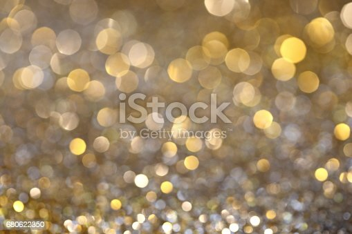 991205326 istock photo Abstract Golden Bokeh background with shining defocus sparkles 680622350
