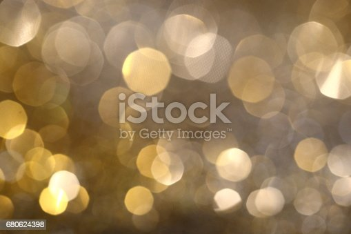 991205326 istock photo Abstract Golden Bokeh background with shining defocus sparkles 680624398