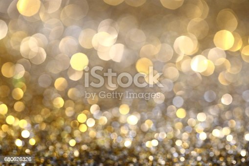 991205326 istock photo Abstract Golden Bokeh background with shining defocus sparkles 680626326