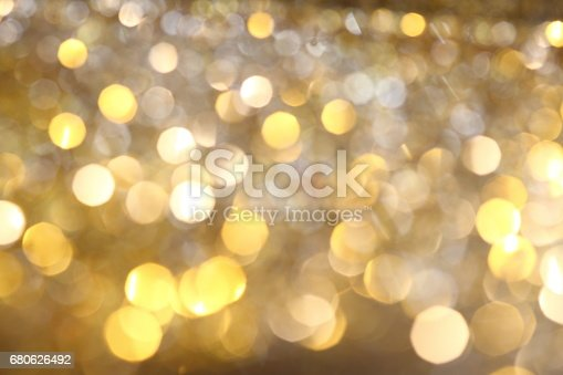 991205326 istock photo Abstract Golden Bokeh background with shining defocus sparkles 680626492