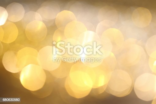 991205326 istock photo Abstract Golden Bokeh background with shining defocus sparkles 680630580