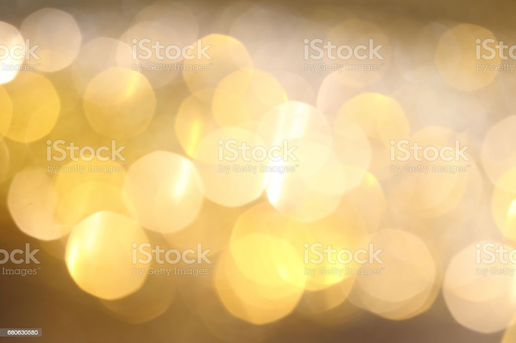 Abstract Golden Bokeh background with shining defocus sparkles stock photo
