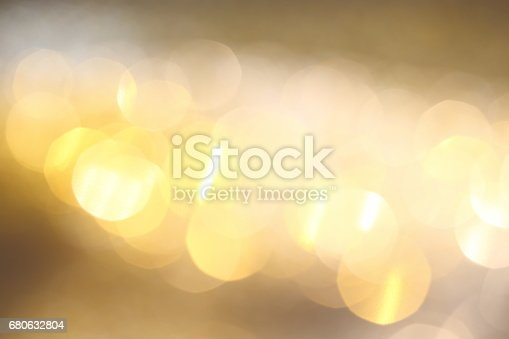 991205326 istock photo Abstract Golden Bokeh background with shining defocus sparkles 680632804