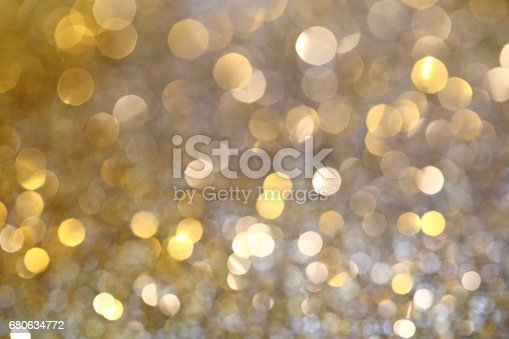 991205326 istock photo Abstract Golden Bokeh background with shining defocus sparkles 680634772