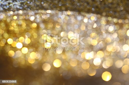 991205326 istock photo Abstract Golden Bokeh background with shining defocus sparkles 680635668